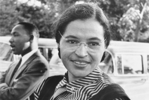 Rosa Parks in 1955, with Martin Luther King, Jr in the background